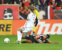 James Riley (2) of D.C. United goes against Real Salt Lake Kyle Beckerman ( 5) D.C. United defeated Real Salt Lake 1-0 in their home opener, at RFK Stadium, Saturday March 9, 2013.