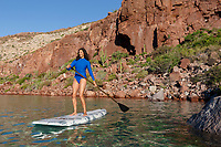 TW40183-D. Woman (model released) using a stand up paddle board (SUP) to cruise along the shoreline of Espiritu Santo Island in the Sea of Cortez. Isla Esp&iacute;ritu Santo is a protected biosphere and top eco-tourism destination for scuba diving, snorkeling, kayaking, hiking, and boating. Baja, Mexico.<br /> Photo Copyright &copy; Brandon Cole. All rights reserved worldwide.  www.brandoncole.com