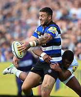 Matt Banahan of Bath Rugby looks to offload the ball after being tackled. Aviva Premiership match, between Bath Rugby and Saracens on September 9, 2017 at the Recreation Ground in Bath, England. Photo by: Patrick Khachfe / Onside Images