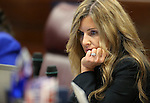 Nevada Assemblywoman Melissa Woodbury, R-Las Vegas, works on the Assembly floor during the final day of the 77th Legislative session at the Legislative Building in Carson City, Nev., on Monday, June 3, 2013. <br /> Photo by Cathleen Allison