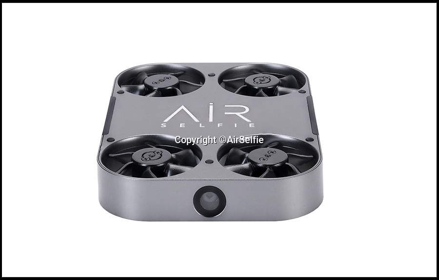 BNPS.co.uk (01202 558833)<br /> Pic: AirSelfie/BNPS<br /> <br /> Selfie drone...<br /> <br /> An amazing new hands free gadget allows selfie-obsessed millennials to get the perfect shot of themselves.<br /> <br /> The AirSelfie is a tiny flying camera that hovers above the taker's head so they can capture memorable moments like never before.<br /> <br /> The pocket-sized flyer is controlled by an app that can be downloaded on most smartphones and can stay in the air for up to five minutes at a time.