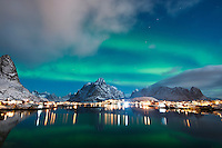Northern Lights - Aurora Borealis fill night sky over Reine, Lofoten Islands, Norway