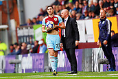 10th September 2017, Turf Moor, Burnley, England; EPL Premier League football, Burnley versus Crystal Palace; Stephen Ward of Burnley rolls up his shirt to wipe the wet ball before a throw in