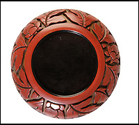 BNPS.co.uk (01202 558833)<br /> Pic:   Dukes/BNPS<br /> <br /> Paper clip saucer sells for £31,000...<br /> <br /> An exceptionally rare 700 year old Chinese lacquer box has sold for £31,000 after being discovered by chance containing a stamp and some paperclips.<br /> <br /> It was spotted by an eagle-eyed auctioneer perched on a hallway mantelpiece during a routine valuation at a detached house in Somerset.<br /> <br /> From a distance it appeared to be made of red plastic, but on closer inspection it was identified as from the Yuan (1279-1368) or early Ming dynasty.<br /> <br /> The 4ins red circular box is carved with a central peony blossom surrounded by leafy stems and budding flowers against a background with a distinctive golden hue.