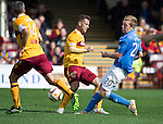 Motherwell v St Johnstone...30.08.14  SPFL<br /> Scott Brown tackles Paul Lawson<br /> Picture by Graeme Hart.<br /> Copyright Perthshire Picture Agency<br /> Tel: 01738 623350  Mobile: 07990 594431