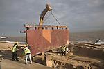 Engineering work on sea defences repairing groyne with steel huge plates Southwold, Suffolk, England- December 2006