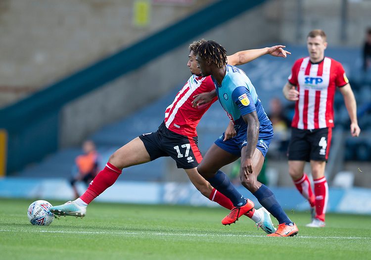 Lincoln City's Tyler Walker battles with Wycombe Wanderers' Anthony Stewart<br /> <br /> Photographer Andrew Vaughan/CameraSport<br /> <br /> The EFL Sky Bet League One - Wycombe Wanderers v Lincoln City - Saturday 7th September 2019 - Adams Park - Wycombe<br /> <br /> World Copyright © 2019 CameraSport. All rights reserved. 43 Linden Ave. Countesthorpe. Leicester. England. LE8 5PG - Tel: +44 (0) 116 277 4147 - admin@camerasport.com - www.camerasport.com