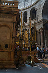 Pilgims wait in line to enter the Aedicule or Kouvouklionm which is a small chapel under the rotunda that encloses the Holy Sepulchre.  The Old City of Jerusalem and its Walls is a UNESCO World Heritage Site