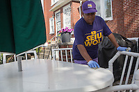 Pennsylvania gubernatorial candidate Tom Wolf walks a day in the shoes of home health care worker Aretha Spady as she cares for her client Leroy Evans in the West Oak Lane section of Philadelphia on October 3, 2014. Wolf helped Spady with tasks such as cleaning and making Mr. Evans' bed, doing laundry, washing dishes, taking Mr. Evans for a walk, and sweeping up the floors. Wolf and Spady held a short press conference about the role of home health workers.
