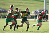 N. Watson looks to push off D. Olsen as he makes a break upfield. Counties Manukau Premier Club Rugby, Pukekohe v Waiuku  played at the Colin Lawrie field, on the 3rd of 2006.Pukekohe won 36 - 14