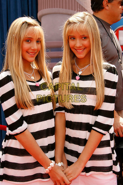 "CAMILLE ROSSO & REBECCA ROSSO.Attending the ""Meet The Robinsons"" Los Angeles Premiere held at the El Capitan Theatre, Hollywood, California, USA, 25 March 2007..half length black and white striped top identical twins sisters siblings .CAP/ADM/RE.©Russ Elliot/AdMedia/Capital Pictures."
