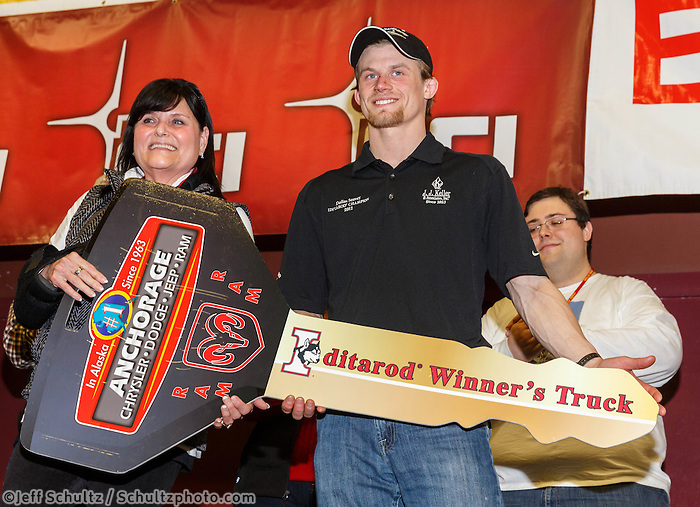 Dallas Seavey gets his key for his new Dodge RAM truck from Anchorage Chrysler Dodge at the musher 's finishers banquet in Nome on Sunday March 16 after the 2014 Iditarod Sled Dog Race.<br /> <br /> PHOTO (c) BY JEFF SCHULTZ/IditarodPhotos.com -- REPRODUCTION PROHIBITED WITHOUT PERMISSION