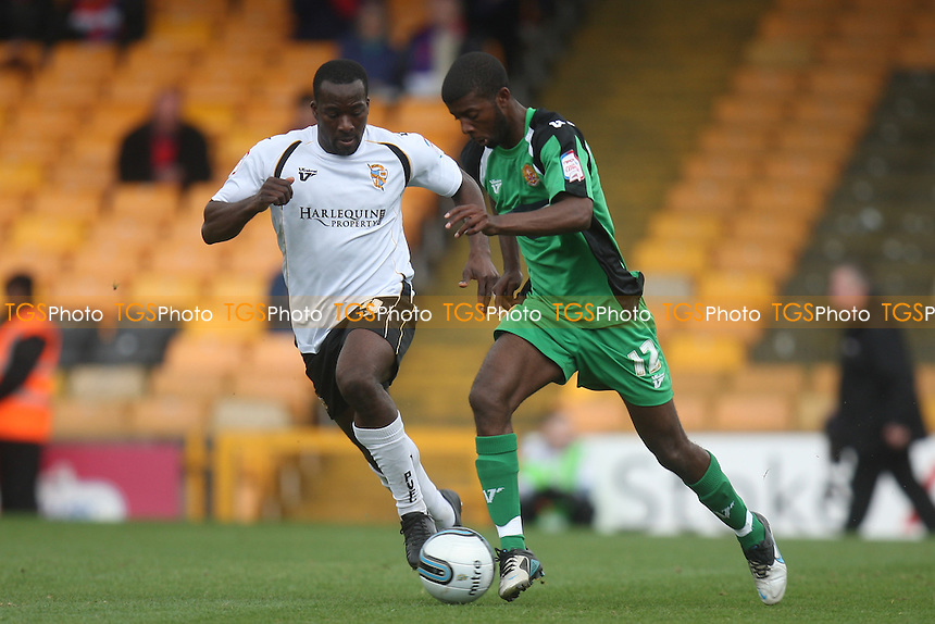 Anthony Griffith of Port Vale and Medy Elito of Dagenham and Redbridge -  Port Vale vs Dagenham and Redbridge - at the Vale Park Stadium - 31/03/12 - MANDATORY CREDIT: Dave Simpson/TGSPHOTO - Self billing applies where appropriate - 0845 094 6026 - contact@tgsphoto.co.uk - NO UNPAID USE.