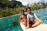 FRENCH POLYNESIA, Moorea. Young kids on canoe at Opunohu Bay.