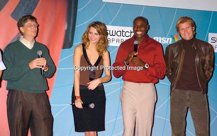 G Nicolas Hayek, Jr, Bill Gates, Mischa Barton, Carl Lewis and Denis Leary ..at the Swatch and Microsoft launch of a new watch line called Paparazzi on October 20, 2004 at The Supper Club. ..Photo by Robin Platzer, Twin Images