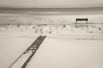 Middle Beach Road. Boardwalk to beach and pavilion in winter with snow. Long Island Sound.