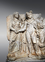 Roman Sebasteion relief sculpture of emperor Claudius and Agrippina, Aphrodisias Museum, Aphrodisias, Turkey. <br /> <br /> Claudius in heroic nudity and military cloak shakes hands with his wife Agrippina and is crowned by the Roman people or the Senate wearing a toga. The subject is imperial concord with the traditional Roman state. Agrippina holds ears of wheat: like Demeter goddess of fertility. The emperor is crowned with an oak wreath, the Corona civica or &ldquo;citizen crow&rdquo;, awarded to Roman leaders for saving citizens lives: the emperor id therefore represented as saviour of the people.