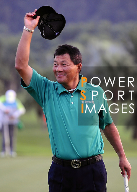 TAIPEI, TAIWAN - NOVEMBER 20:  Lu Chien Soon of Taiwan celebrates on the 18th green after winning the Fubon Senior Open at Miramar Golf & Country Club on November 20, 2011 in Taipei, Taiwan. Photo by Victor Fraile / The Power of Sport Images