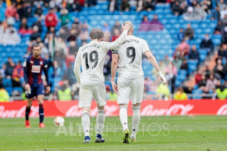 Real Madrid's Alvaro Odriozola (L) and Karim Benzema (R) celebrate goal during La Liga match between Real Madrid and SD Eibar at Santiago Bernabeu Stadium in Madrid, Spain.April 06, 2019. (ALTERPHOTOS/A. Perez Meca)