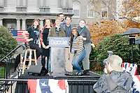 Sanders campaign workers and volunteers gather for a group photo behind the podium after Democratic presidential candidate and Vermont senator Bernie Sanders spoke at a small rally outside the NH State House after he filed the required paperwork and paid the $1000 filing fee to be on the 2020 Democratic presidential ballot in the NH Secretary of State's Office in Concord, New Hampshire, on Thu., October 31, 2019. As part of the filing process, Sanders signed a ceremonial primary ballot that is signed by all candidates in the race.