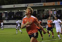 Cameron McGeehan of Luton Town celebrates his penalty and also putting his side 1-0 up during the Sky Bet League 2 match between Luton Town and Newport County at Kenilworth Road, Luton, England on 16 August 2016. Photo by Liam Smith.