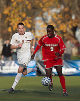 Rutgers University forward Ibrahim Kamara (9) brings the ball forward as Boston College midfielder/defender Conor Fitzpatrick (8) defends. Rutgers University defeated Boston College in penalty kicks after two overtime periods in NCAA Division I tournament action, at Newton Campus Field, November 20, 2011.