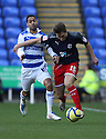 Luke Freeman of Stevenage (on loan from Arsenal) and Jobi McAnuff of Reading battle.Reading v Stevenage - FA Cup 3rd Round - Madejski Stadium,.Reading - 7th January, 2012.© Kevin Coleman 2012