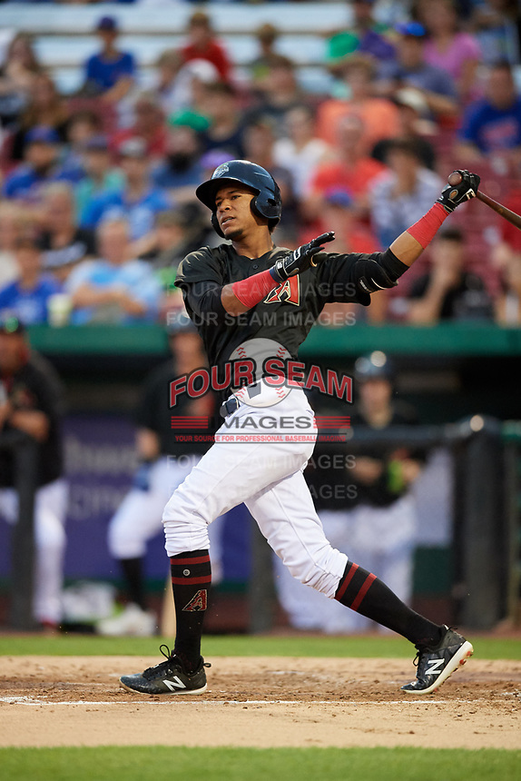 Kane County Cougars right fielder Yan Sanchez (2) follows through on a swing during a game against the South Bend Cubs on July 21, 2018 at Northwestern Medicine Field in Geneva, Illinois.  South Bend defeated Kane County 4-2.  (Mike Janes/Four Seam Images)