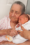 3 day old newborn baby boy held up on grandmother's shoulder, grandmother has Alzheimer's disease