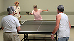 Mildred Swiec, left, and Shirley Ling play ping pong against Wayne Lenhares and Vernon Moss at the Carson City Senior Citizen Center in Carson City, Nev., on Wednesday, Aug. 22, 2012.<br />