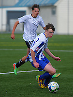 Action from the 2nd XI college football match between St Patrick's College (Town) College (blue) and Palmerston North Boys' High School (white) at St Pat's College Artificial Turf, Wellington, New Zealand on Wednesday, 13 May 2015. Photo: Dave Lintott / lintottphoto.co.nz