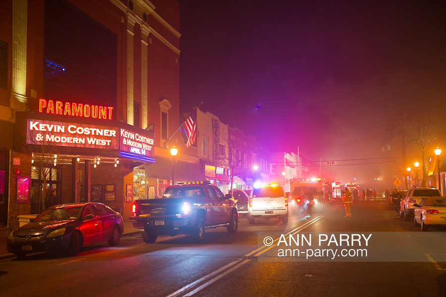 March 1, 2014 - Huntington, New York, U.S. - A dangerous fire rages in the heart of Huntington village, down the block from the famous Paramount Theater, on New York Avenue. Firefighters came from many surrounding towns of Suffolk County, Long Island, and huge clouds of smoke lit up the night sky for blocks.