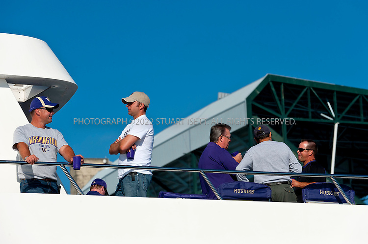 9/24/2011--Seattle, WA, USA...The Big Dawg parks at docks next to Husky Statium...The 'Big Dawg', owned by Lisa and Tim Kittilsby, is the biggest, most prominent boat that attends regular boat tailgate parties on docks near the UW (University of Washington) Husky Stadium. Up to 500 boats will tie up outside Husky Stadium on football game days, ranging from from small boats to huge yachts. The Big Dawg is a 92-foot, two-story yacht that dominates the tailgate parties...The tradition started when Lisa and Tim Kittilsby's parents, Frank and Jeanie Miles, took a 23-foot boat called The Mixer to a game over 40 years ago...©2011 Stuart Isett. All rights reserved.