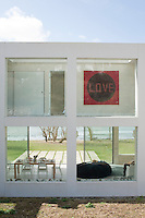 The heart of the beach house is a see-through space with glazing front and back allowing the eye to pass through the building to the beach and the sea