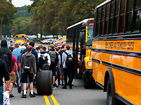 Sep 13, 2019; Mohnton, PA, USA; A student rolls a Goodyear racing tire towards a school bus during NHRA qualifying for the Keystone Nationals at Maple Grove Raceway. Mandatory Credit: Mark J. Rebilas-USA TODAY Sports