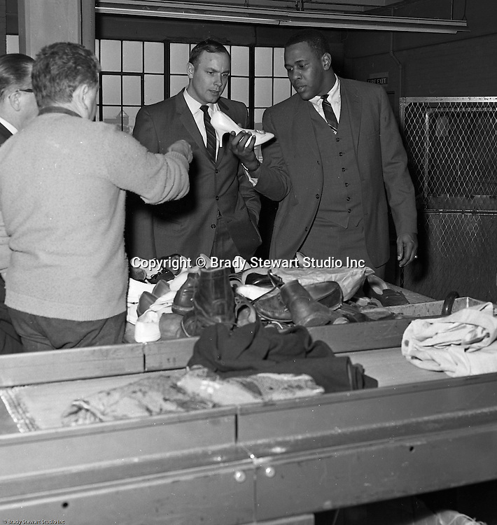 Pittsburgh PA:  Willie Stargell and Tommy Sisk getting a tour of the Goodwill Industries facility - 1966.  Willie and a many other Pittsburgh Pirates were very involved in the community supporting charitable causes.<br />