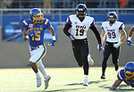 BROOKINGS, SD - DECEMBER 2: Cade Johnson # 15 from South Dakota State returns a kick off 70 yards past Suni Lane #19 from Northern Iowa during their FCS Division 1 playoff game Saturday afternoon at Dana J. Dykhouse Stadium in Brookings, SD. (Photo by Dave Eggen/Inertia)