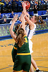 BROOKINGS, SD - JANUARY 6: Tagyn Larson #24 from South Dakota State University drives to the basket against Emily Dietz #34 from North Dakota State University  during their game Saturday afternoon at Frost Arena in Brookings, SD. (Photo by Dave Eggen/Inertia)
