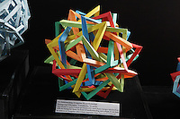 OrigamiUSA Convention 2015 Exhibition. Six Intersecting Irregular Hyperboloidal Hexagonal Rhombic Tetrahedra designed and folded by Byriah Loper, KY.