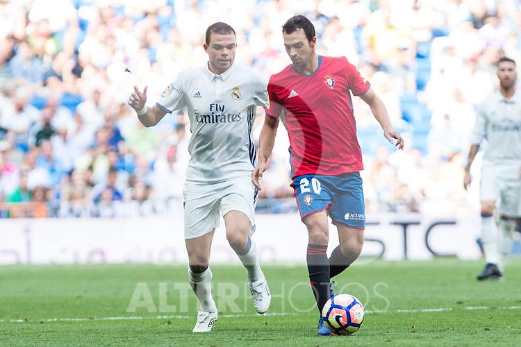 Real Madrid's Pepe Club Atletico Osasuna's De Las Cuevas during the match of La Liga between Real Madrid and Club Atletico Osasuna at Santiago Bernabeu Estadium in Madrid. September 10, 2016. (ALTERPHOTOS/Rodrigo Jimenez)