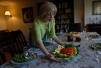 Gilda Angel serves a Salmon dish for lunch at the apartment she shares with her husband, Rabbi Mark Angel in Manhattan...©Andrew Testa