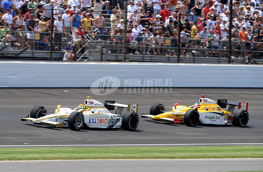 May 30, 2010; Indianapolis, IN, USA; IndyCar Series driver Alex Lloyd (19) leads Bertrand Baguette (36) during the Indianapolis 500 at the Indianapolis Motor Speedway. Mandatory Credit: Mark J. Rebilas-