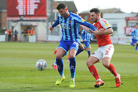 Blackpool's Gary Madine under pressure from Fleetwood Town's Lewie Coyle<br /> <br /> Photographer Kevin Barnes/CameraSport<br /> <br /> The EFL Sky Bet League One - Fleetwood Town v Blackpool - Saturday 7th March 2020 - Highbury Stadium - Fleetwood<br /> <br /> World Copyright © 2020 CameraSport. All rights reserved. 43 Linden Ave. Countesthorpe. Leicester. England. LE8 5PG - Tel: +44 (0) 116 277 4147 - admin@camerasport.com - www.camerasport.com