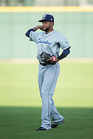 Ronny Rodriguez (13) of the Columbus Clippers warms up in the outfield prior to the game against the Charlotte Knights at BB&T BallPark on May 3, 2016 in Charlotte, North Carolina.  The Clippers defeated the Knights 8-3.  (Brian Westerholt/Four Seam Images)