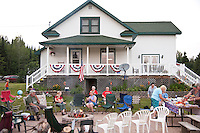 Fourth of July Indepenence Day party with a patriotic decorated farmhouse.