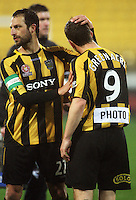 Phoenix skipper Andrew Durante congratulates Chris Greenacre after the match during the A-League football match between Wellington Phoenix and Perth Glory at Westpac Stadium, Wellington, New Zealand on Sunday, 16 August 2009. Photo: Dave Lintott / lintottphoto.co.nz