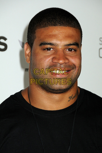 "SHAWNE MERRIMAN.Matt Leinart's 4th Annual ""Bowling With The Stars"" Event held at Lucky Strike Lanes, Hollywood, California, USA..July 15th, 2010.headshot portrait tattoo stubble facial hair black .CAP/ADM/BP.©Byron Purvis/AdMedia/Capital Pictures."