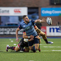 Aled Summerhill of Cardiff Blues offloads under pressured from Dougie Fife of Edinburgh during the Guinness PRO14 match between Cardiff Blues and Edinburgh Rugby at BT Sport Cardiff Arms Park, Cardiff, Wales on 1 September 2017. Photo by Mark  Hawkins.