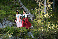 Altaussee, Ausseerland, Steiermark, Styria, Austria, September 2008.  Two women dressed in traditional clothing called dirndl hike along the lake Altaussee and get to hithc a ride with a 'plaette' a flat rowboat. The province of Styria is known for its green alpine landscape, good food and many lakes. Photo by Frits Meyst/Adventure4ever.com