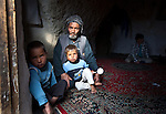 November 2012, Bamiyan, Afghanistan: Local Hazara man Ibrahim who lives in a cave in Bamiyan with his family including sons  Ali Qurbani (3) and Yassin (5) . Their cave is next to the empty Buddhas of Bamiyan niches, two 6th century monumental statues of standing buddha carved into the side of a cliff in the Bamyan valley in the Hazarajat region of central Afghanistan. The valley is home to many Hazara's, who have often made up vast numbers of refugees to Australia, having been persecuted and driven from their homes in both Afghanistan as well as from Quetta in Pakistan where a lot of displaced Hazara fled to during the Taliban years. Bamiyan is home to a lot of Hazara who are Shia muslim and as such are looked down upon by the Sunni Pashto tribes that make up the population majority in Afghanistan.   Picture by Graham Crouch/The Australian Magazine.